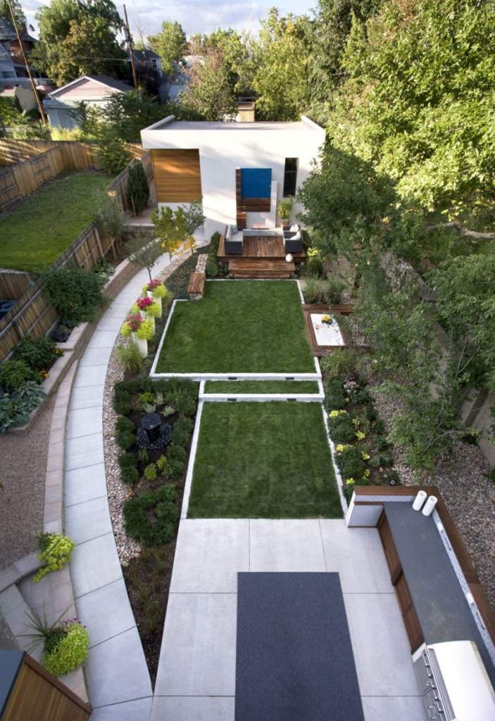 seating area, sandbox, outdoor kitchen in backyard landscaping ideas
