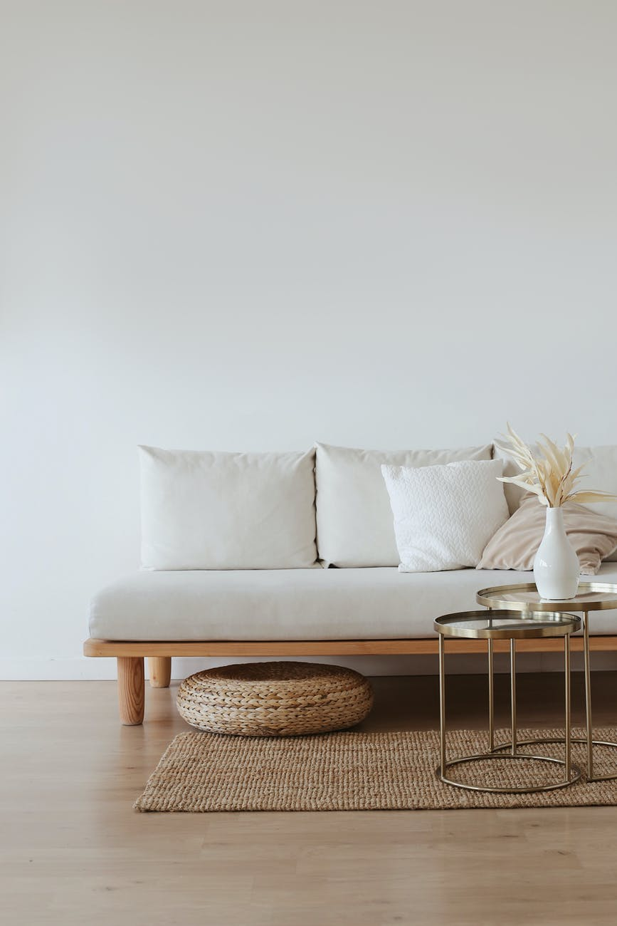 white couch on wooden floor