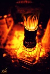 Jack Daniels by a fire. Photo: Pushp Deep Pandey on Flickr. (Direct website link embedded within.)