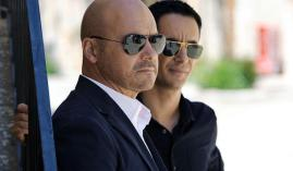 Montalbano (left) in the shades with one of his detectives.