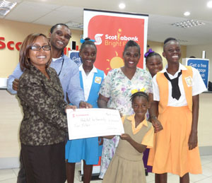 Scotiabank's Jennifer Cipriani (left), Habitat Guyana's Rawle Small, Althea Boucher and her four daughters.