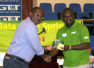 Receiving an award for 20 years of service to the ICT industry from UG's Dept. of Computer Studies.