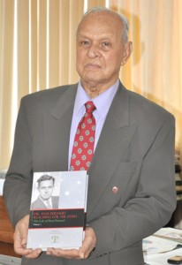 Dr. Yesu Persaud with his book.