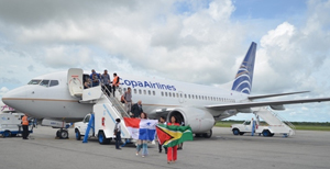 Officials bearing the Guyana and Panama Flags as they disembark the inaugural flight of  COPA Airline