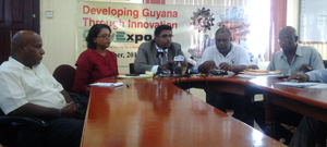 Tourism Minister Irfaan Ali (centre) with members of the Guyexpo Planning Committee