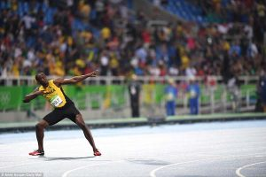 Bolt performs his trademark lightning bolt celebration after capturing the gold medal on Thursday night.