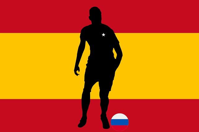スペイン国旗をイメージした背景に人のシルエット