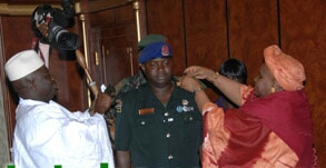 Col. Lamin S. Sanneh being decorated by Jammeh Vice President/State House photo