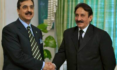 File photo shows Pakistan's Chief Justice Chaudhry shaking hands with PM Gilani in Islamabad