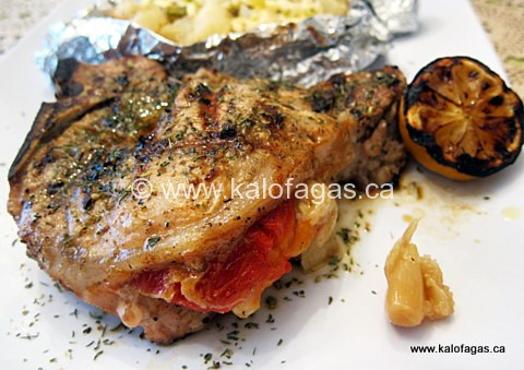 Extra-Thick Pork Chop Stuffed with Roasted Red Peppers & Graviera
