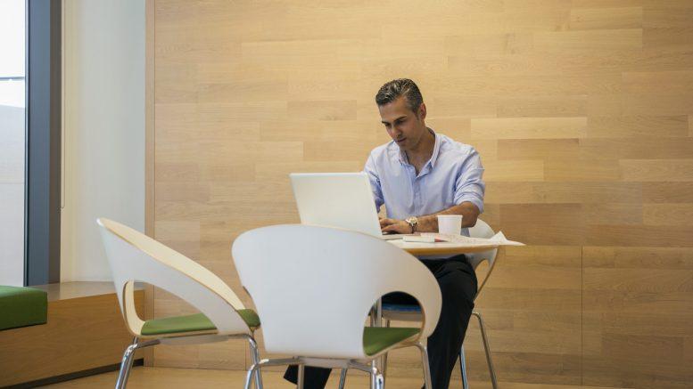 Kal Sabir as manager at desk.