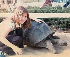 kama as child petting giant turtle