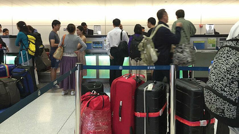 4 Çinli Erkek Ekstra Bagaj Ücreti Ödememek İçin bakın ne Yaptı