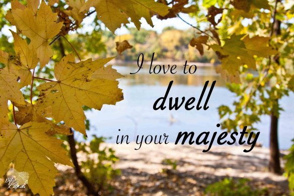 a lake framed by yellow fall leaves with the caption i love to dwell in your majesty