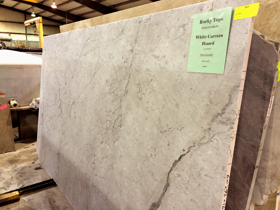 white carrara marble honed slab