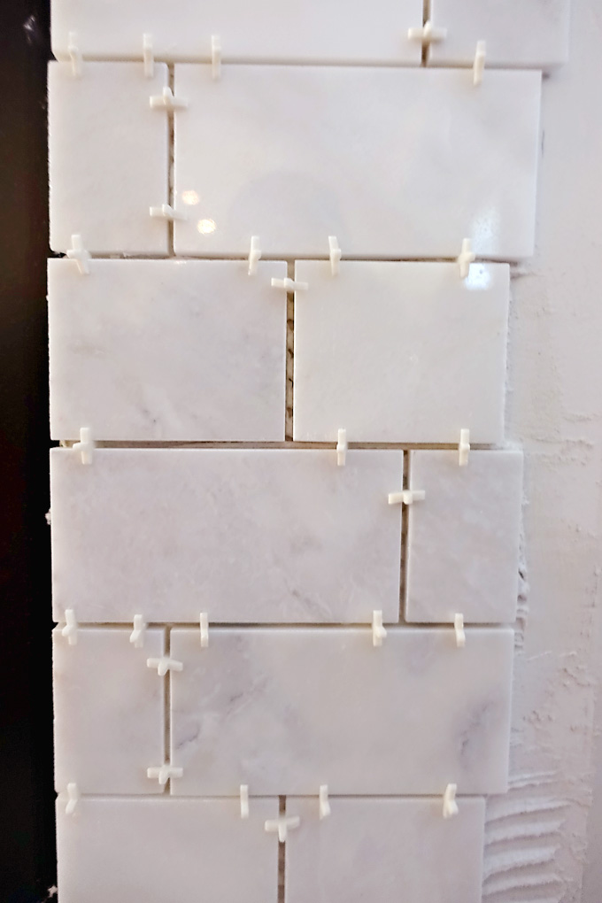 Fireplace-Makeover-Greecian-White-Marble-Tile-Brick-Pattern-01