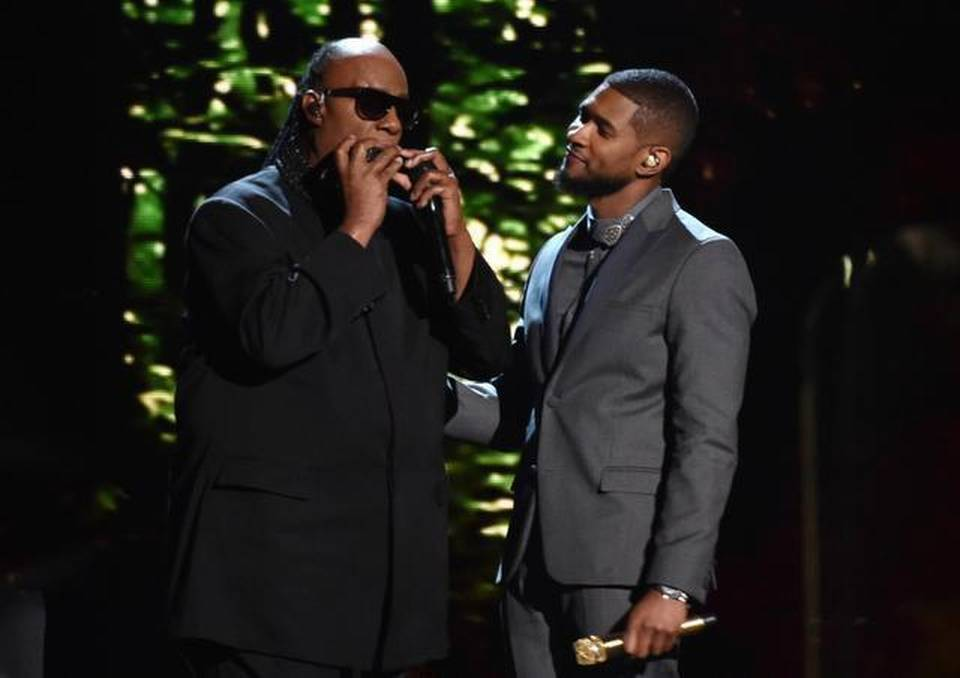 Stevie Wonder left, and Usher perform at the 57th annual Grammy Awards on Sunday, Feb. 8, 2015, in Los Angeles.