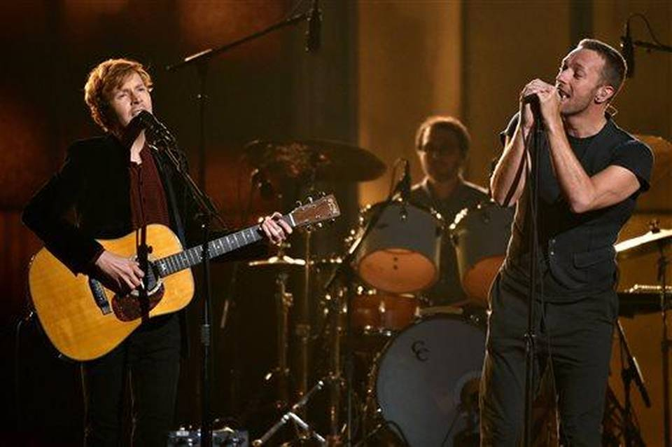 Beck, left, and Chris Martin perform at the 57th annual Grammy Awards on Sunday, Feb. 8, 2015, in Los Angeles. (Photo by John Shearer/Invision/AP)