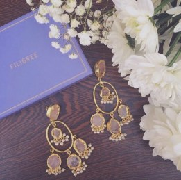 These uncut rose quartz and freshwater pearl earrings will elevate your dholki outfit