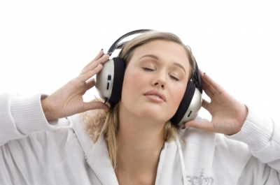 Young lady listening to music with closed eyes