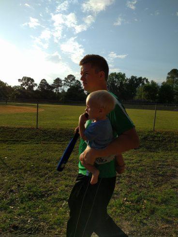 Stefen and Houston walking to softball