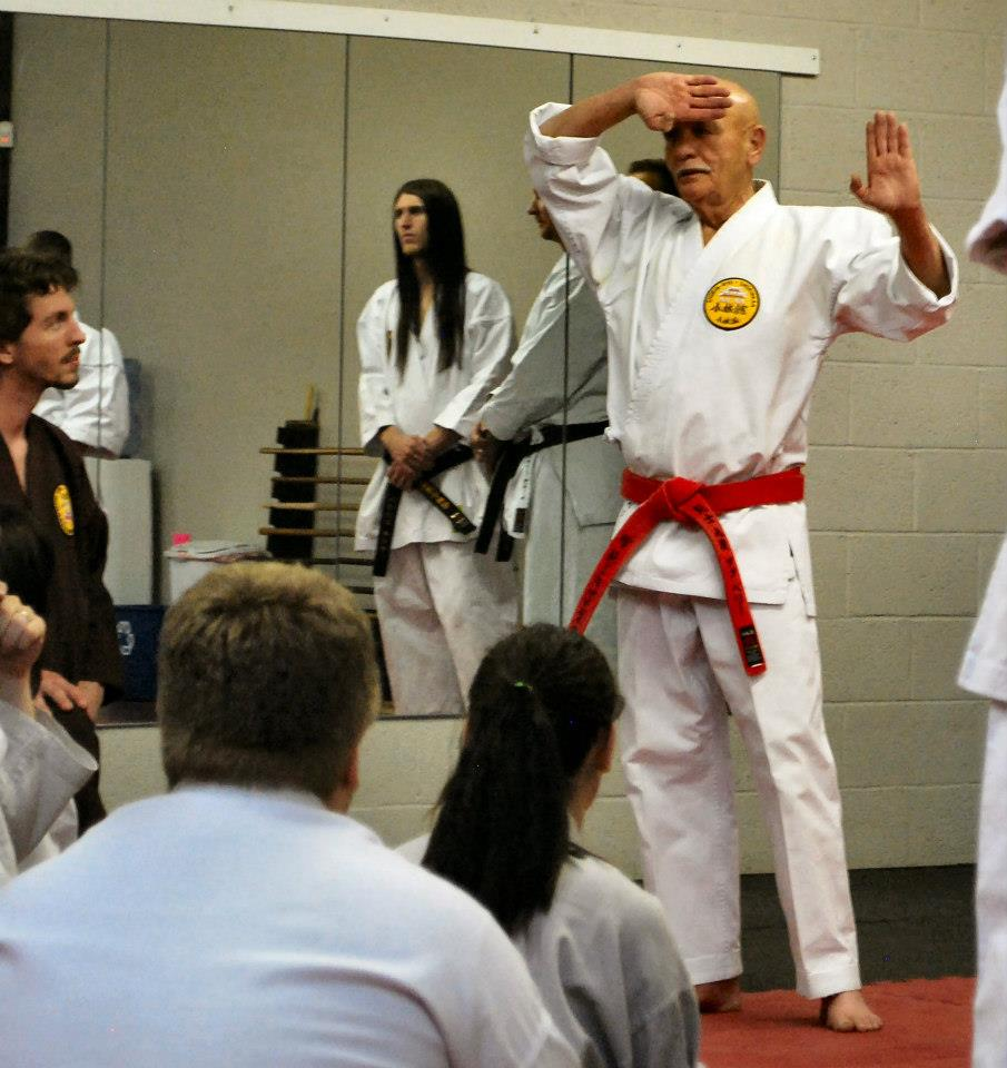 Doug Perry, Hanshi, Judan, explaining the opening kamae of Pinan Yondan