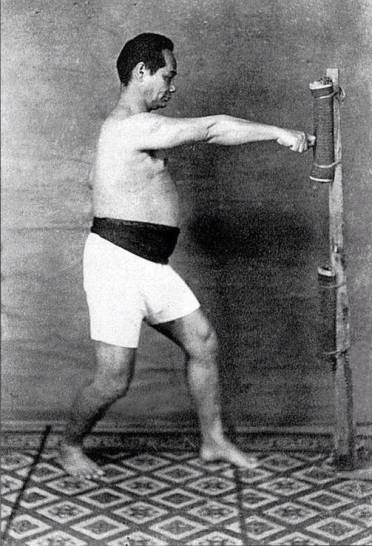 Motobu Choki working ipponken (single knuckle fist), commonly used in kyusho/chibudi, on the makiwara