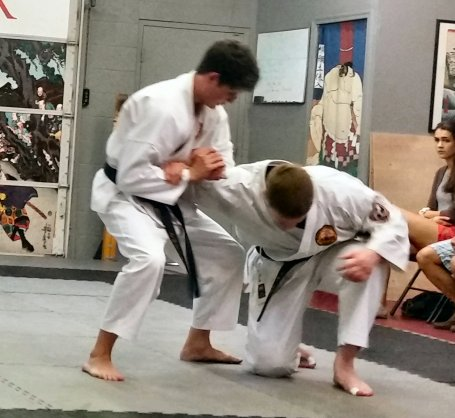 Cameron applying ude-garami to me during technique drills