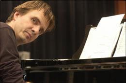 Picture of Karel Van Marcke at the piano