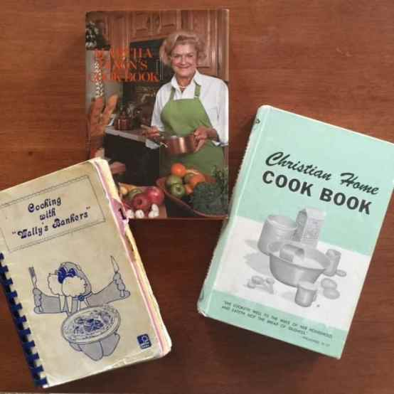 Three well-used cookbooks from my kitchen. One from the bank my Aunt Patty worked at when I got engaged. The top one my mom gave me when I got married {it is the same one she's had since 1960} and the third I found at a yard sale when I first had kids.