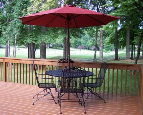 There's much to do inexpensively outside. First of all, clean up. Get rid of anything old and ugly sitting around the house including pots, dead plants, weeds, trash; you get the point.