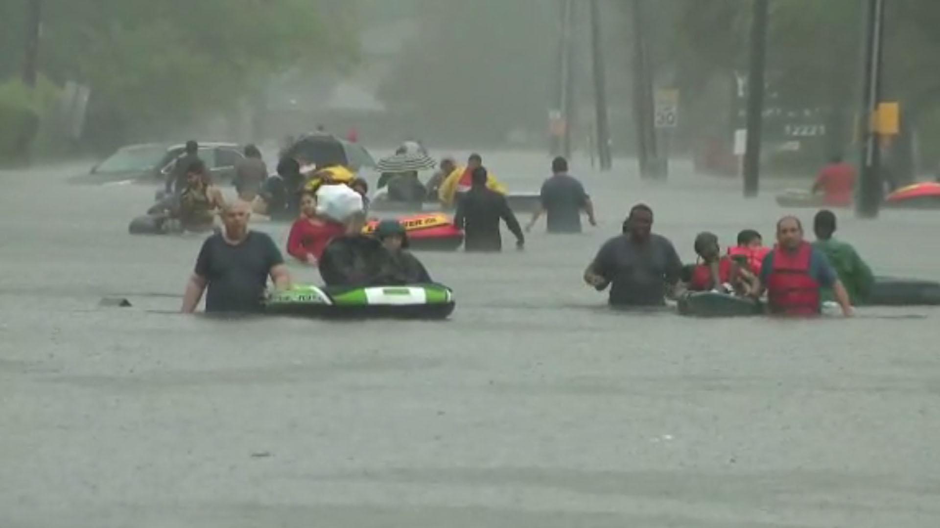 Evacuees escape flooding in Houston, Harvey, screenshot_1503847907619-159532.jpg15097042