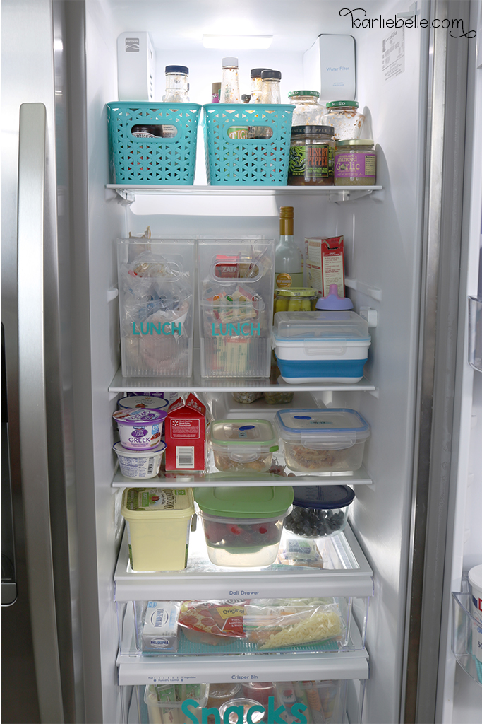 Tackling your Home Project List- Refrigerator Organization. Use containers and baskets to group like foods together.