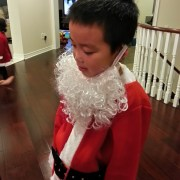 Marcus trying out Santa's beard