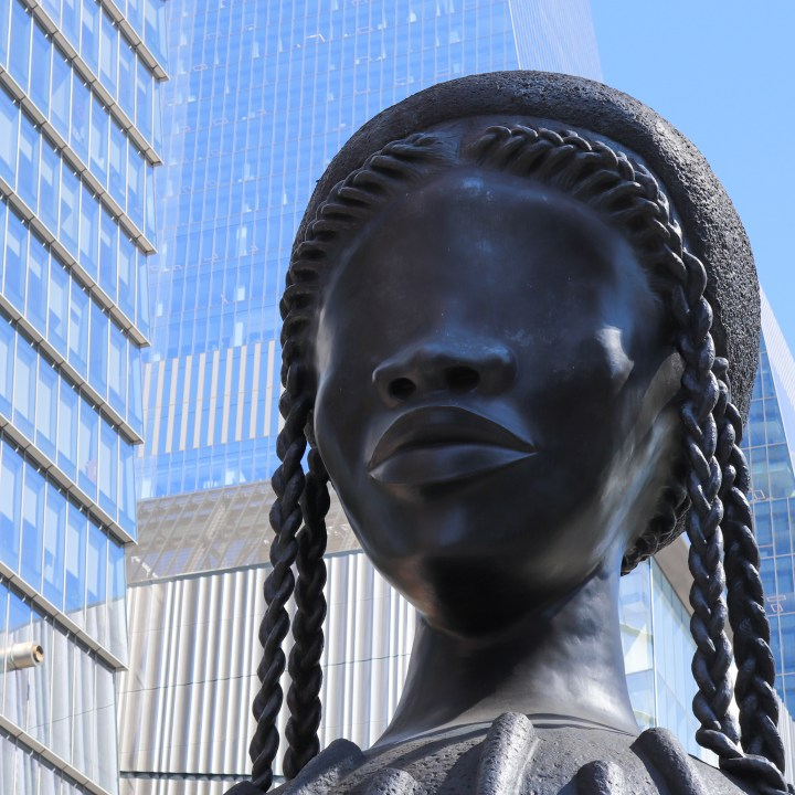 A metal sculpture at the Hudson Yards - a giant female head with braided hair.