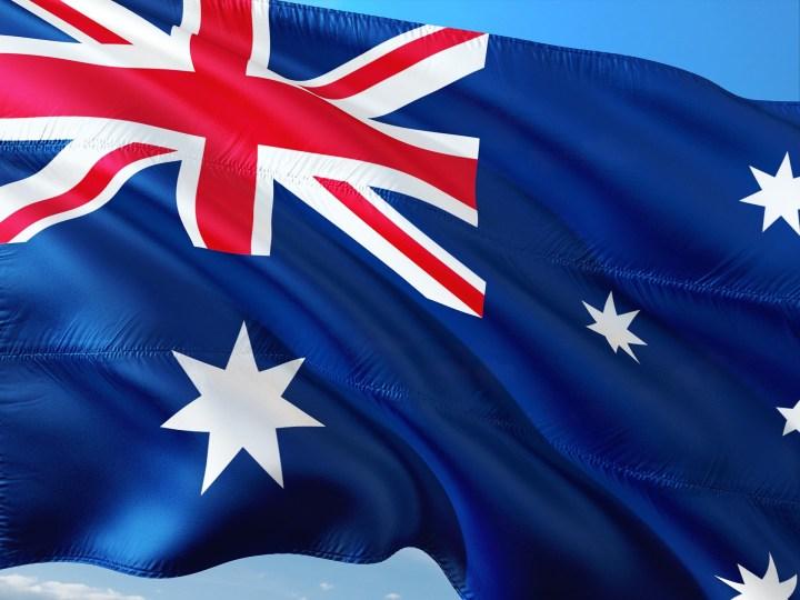 An Australian Flag fluttering in the wind.