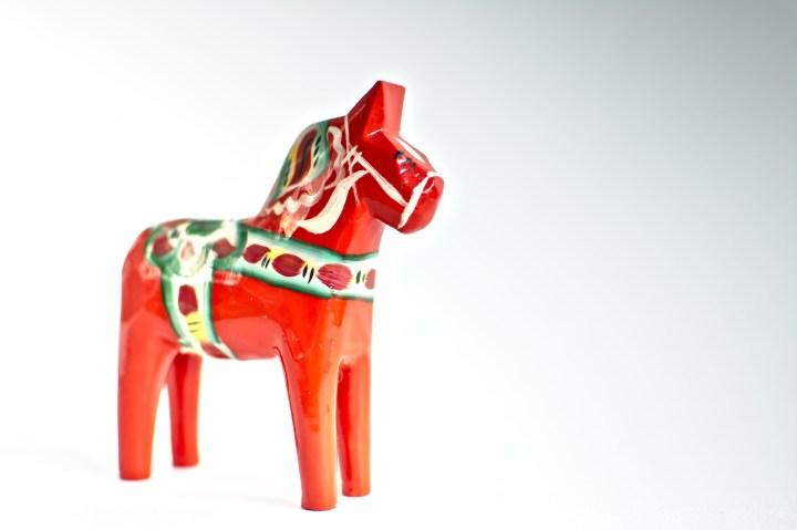 Dalahäst are horses painted red with white patterns on top.