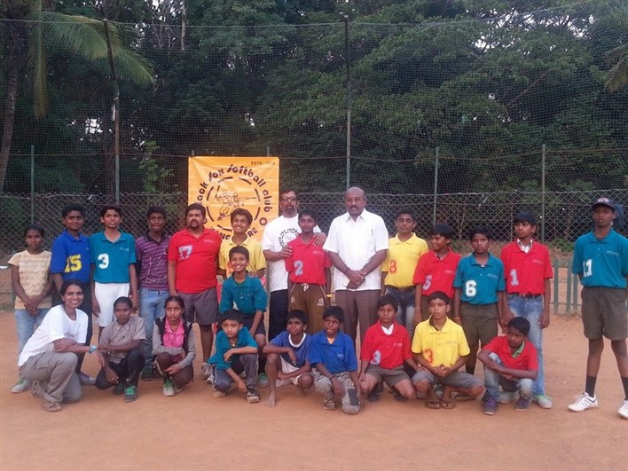 Dilip Kudwalli standing in the centre with kids from Surabhi Foundation and Sheetal sitting on the extreme left.