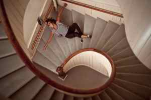 A man with Visual Processing Disorder (VPD) stumbles down the stairs
