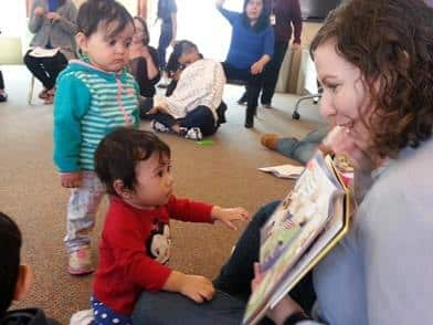 "At a TRC Mother's Day event, a volunteer reads, ""Are You My Mother?"""