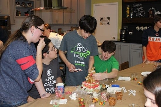 Making gingerbread houses with all the fixings (courtesy)
