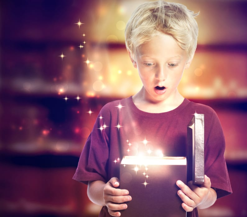 Boy has surprised expression as he opens gift box