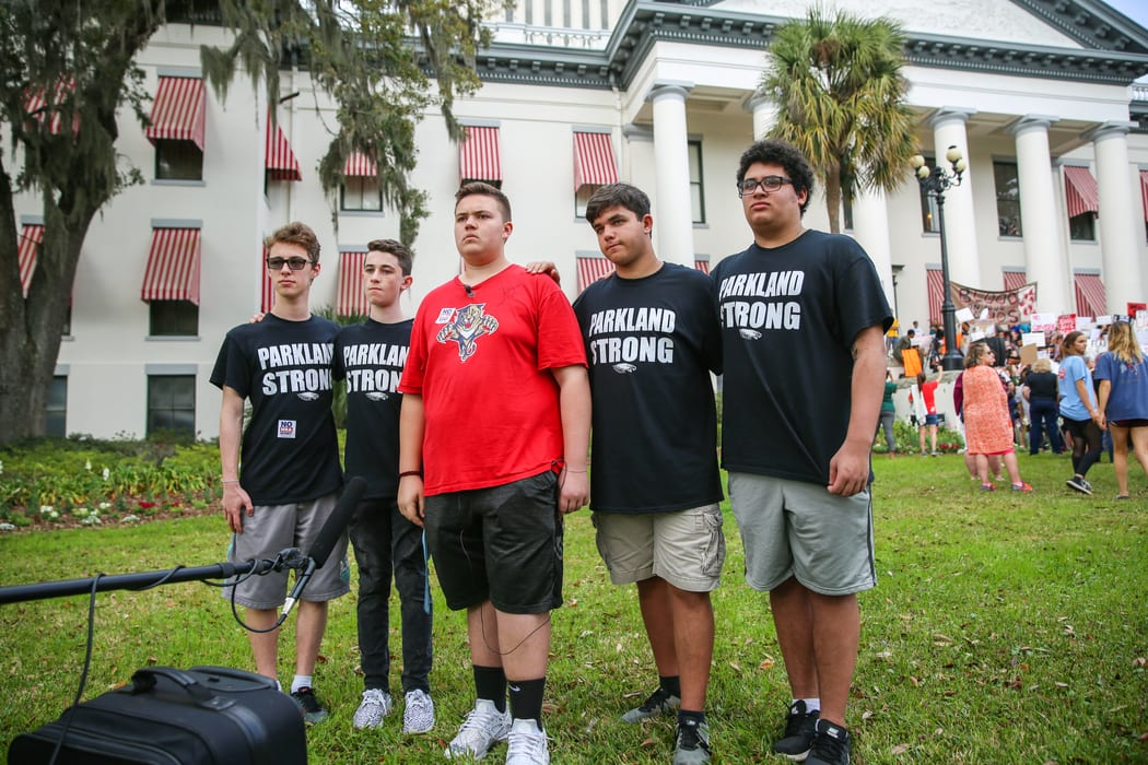 Teenage boys wear shirts commemorating the Parkland mass shooting