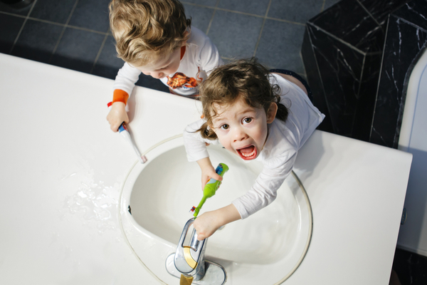 Twins brush their teeth