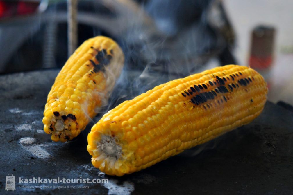 Seasonal fruits of the land: corn on the cob, chestnuts, pumpkin