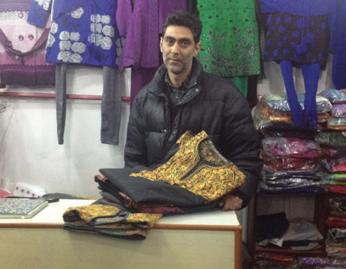 Basharat Hussain Khan at his shop in Maharaja Bazar with pieces of revived Pherans.