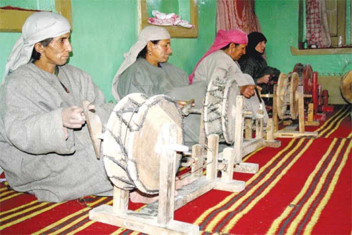 Kashmiri Women on spinning wheels