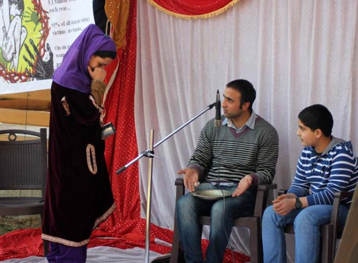 Members of the group performing skit on the occasion. Photo: Durdana Bhat