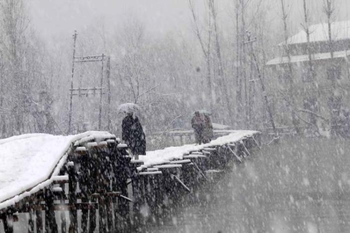Palpable Peace: People passing on the foot bridge in Dal Lake