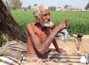 Kamru Sai sitting outside his house in Fattowal.